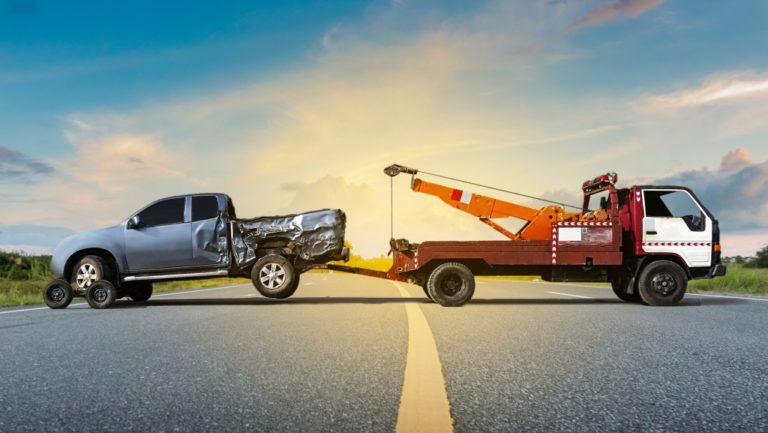 tow truck and a crashed vehicle