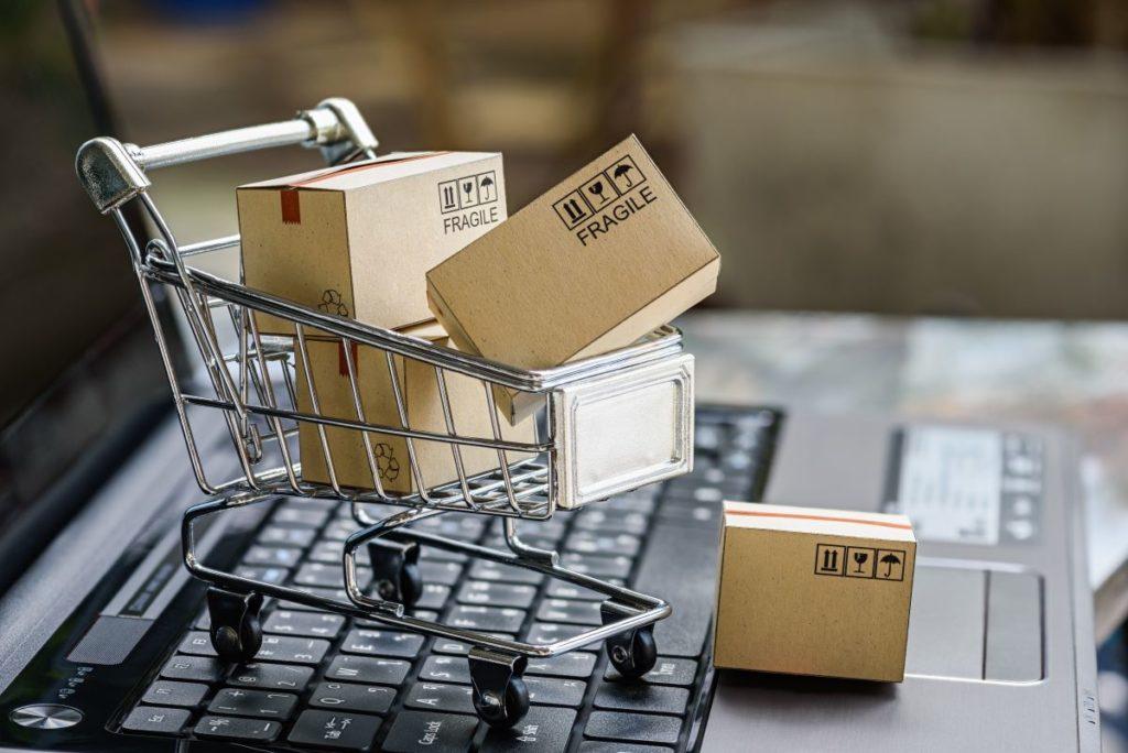 miniature shopping cart on laptop