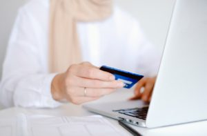 person using their credit card online