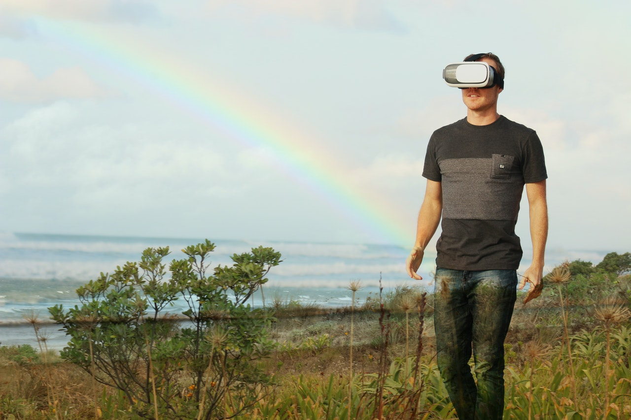 man using VR goggles outdoor