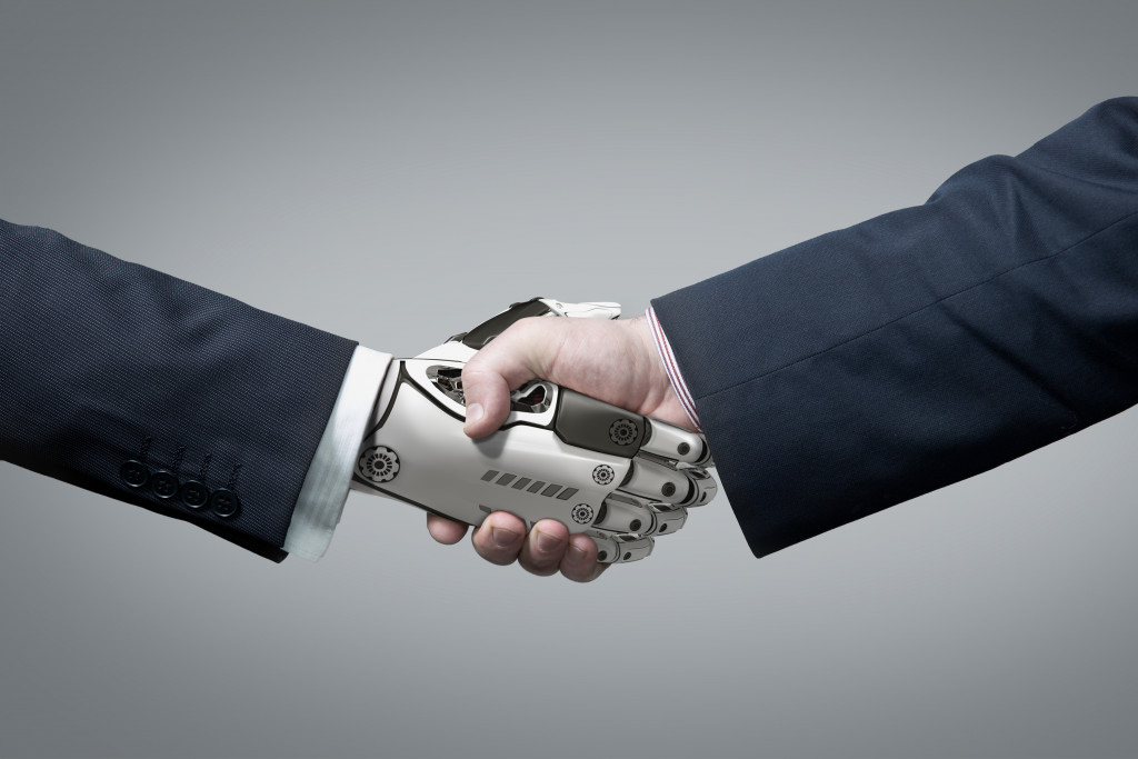 robotic arm shaking hands with a human hand