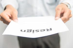 man passing resignation letter