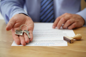 person holding a house key